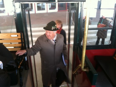 Rochester Mayor Ardell Brede boards one of two trolleys for a tour of the DMC District with fellow DMCC Board members.