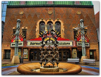 An image taken through a fountain outside the theater's main entrance on Peace Plaza