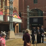Rochester Mayor Ardell Brede addresses media at today's event, announcing the city's proposed purchase of the Chateau Theatre. Behind him are Mayo Clinic CEO John Noseworthy, M.D., DMC Corporation Board Chairwoman Tina Smith, and Rochester City Council President Randy Staver.